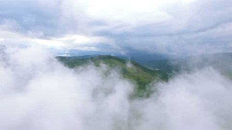 4K .Aerial. Flight in mountains  like bird through clouds.