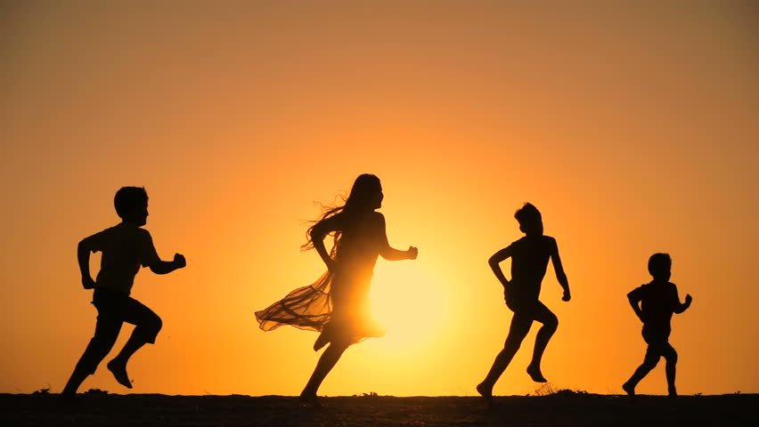 Silhouette of five kids running at hill against sunset, slow motion | Shutterstock HD Video #30176368