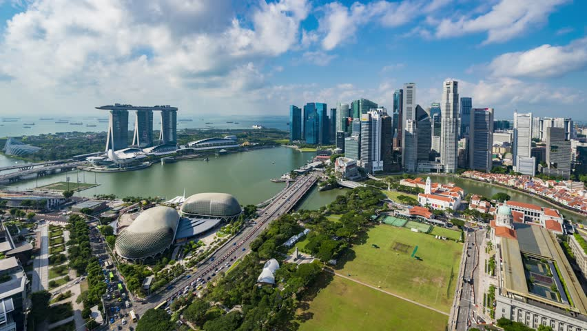 SINGAPORE, SINGAPORE - OCTOBER 2014: famous city flyer view on modern hotel and museum 4k time lapse circa october 2014 singapore, singapore.