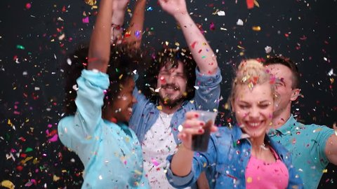 mixed race people celbration and party with confetti shower