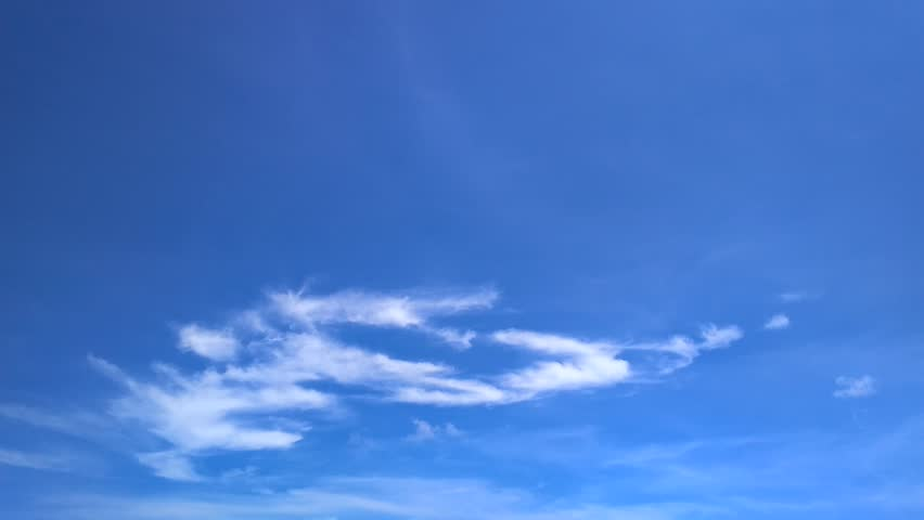 Time lapse of white fluffy clouds over blue sky #30227878