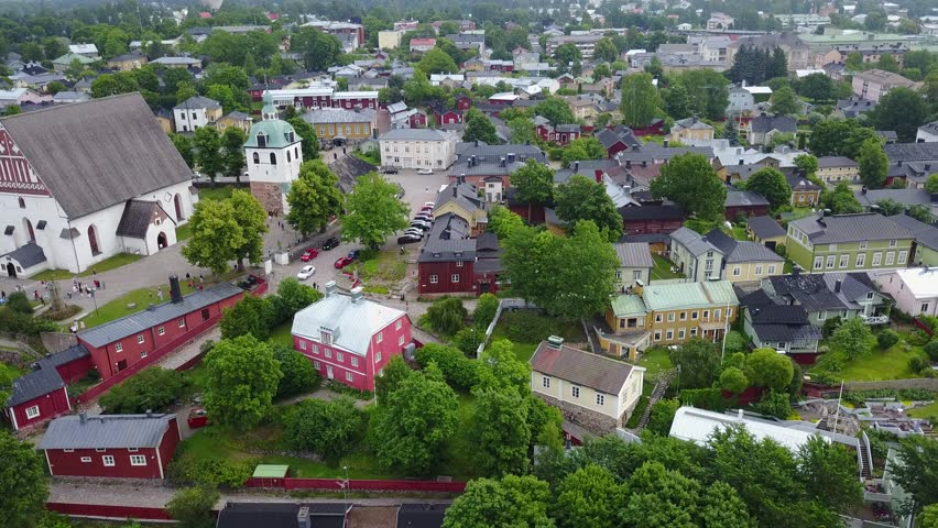 4K aerial video footage view of medieval Porvoo old town on river Porvoonjoki, cathedral, river embankment, boats, old warehouses and area 50 km east of Helsinki, capital of Finland in northern Europe