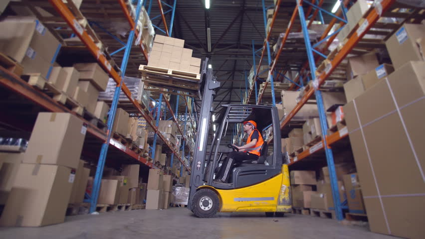 Forklift operator puts boxes with goods on the metal racks | Shutterstock HD Video #30247303
