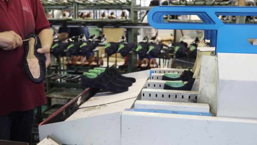 Worker works with suede shoes in shoes factory, slow motion | Shutterstock HD Video #30251038