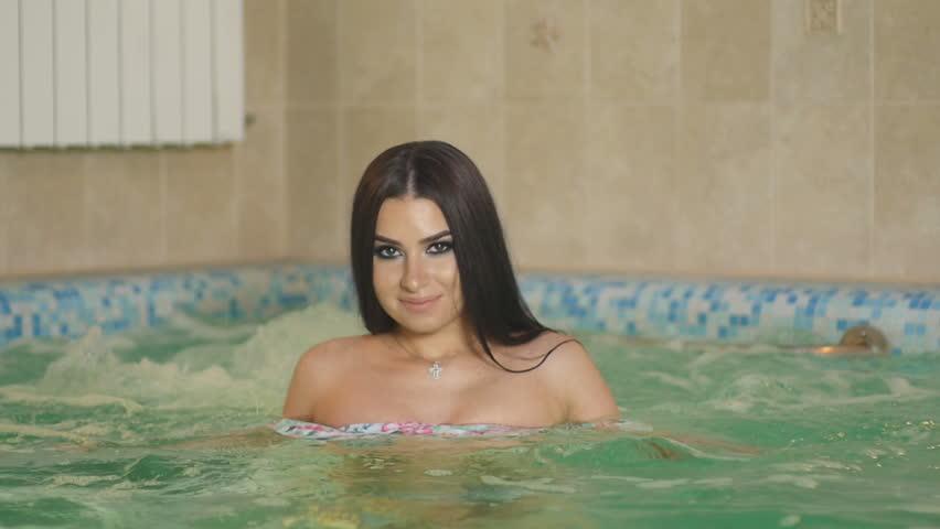 Girl Swims in The Pool