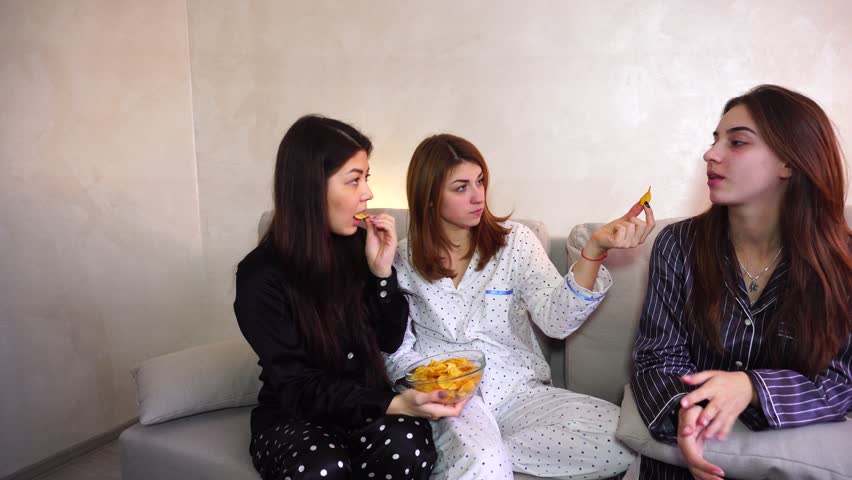 Two friends urge woman to eat bad food. girl is on diet. concept of healthy intuitive nutrition, fast food debris, gluten-free lactose-free vegan vegeterian diet