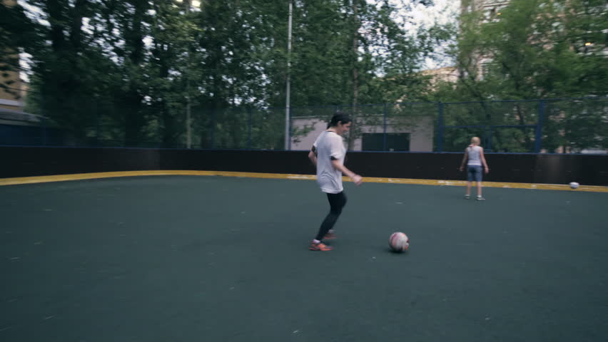 Sexy young woman soccer player playing football. Woman soccer player. Woman  football team. Women playing football outdoors slow motion. Female  footballer b418315f516