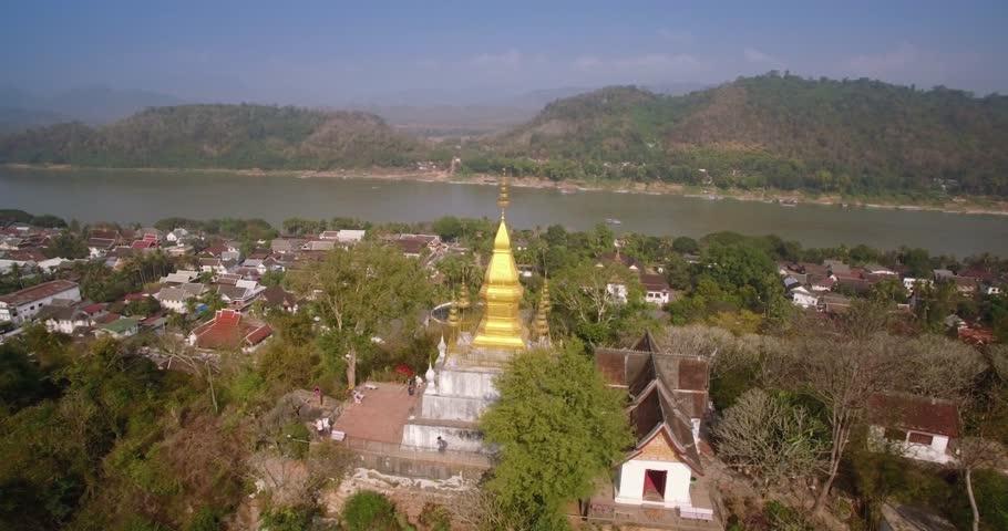 Aerial Slider Shot Of Golden Chedi On Mount Phousi, Luang Prabang, Laos