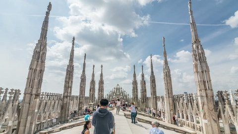 MILAN, ITALY - CIRCA 2017: The Milan Cathedral (Duomo di Milano) rooftop. Italian Gothic architecture. Hyperlapse video.