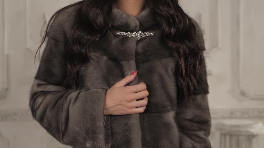Beauty Fashion Model Girl in Mink Fur Coat. Beautiful Woman in Luxury Brown Fur Jacket . Winter Fashion