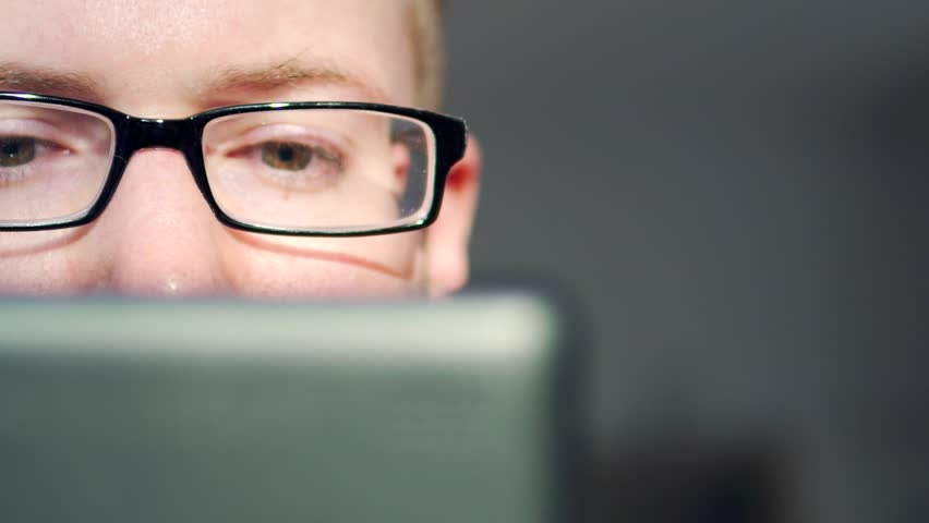 Man Using Digital Touchscreen Tablet Close Up, Detail of Eyes. White Caucasian Wearing Glasses. Young and Handsome Adult in 30's. | Shutterstock HD Video #30396208