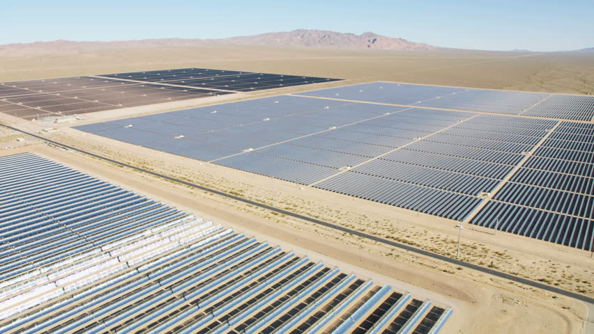 Aerial desert view Photovoltaic solar panels harvesting clean energy from the sun natural alternative power Las Vegas Nevada USA RED WEAPON   Shutterstock HD Video #30458338