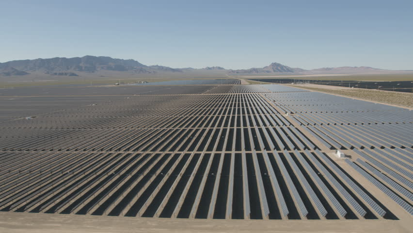 Aerial view Nevada Solar One Photovoltaic Solar units being used to produce natural clean energy for business industrial production Nevada USA RED WEAPON | Shutterstock HD Video #30458398