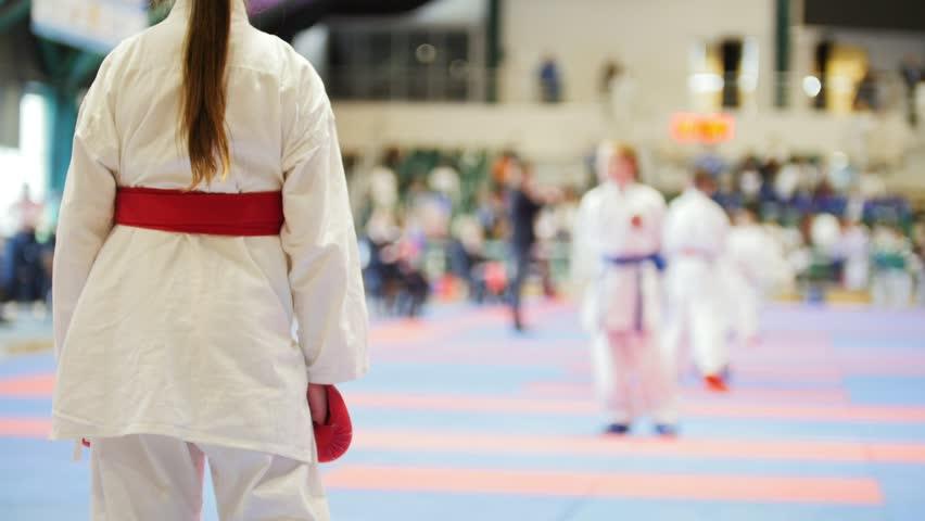 Sports teenagers - kid sportsmen at karate tatami - ready for fight