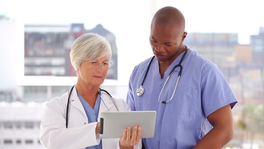 Happy Doctor And Nurse Looking Stock Footage Video 100 -8547