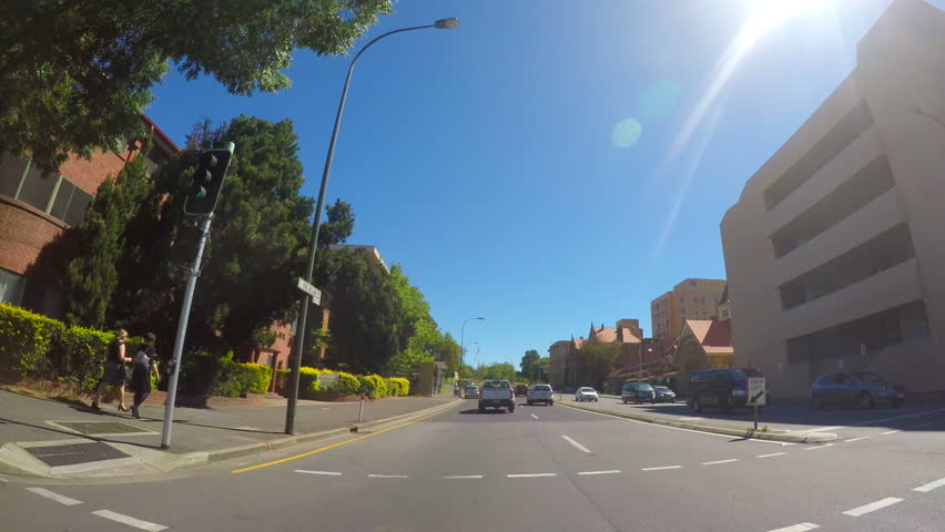 ADELAIDE, SOUTH AUSTRALIA - JUNE 12, 2017: Automobile POV driving along King William Road towards North Adelaide.