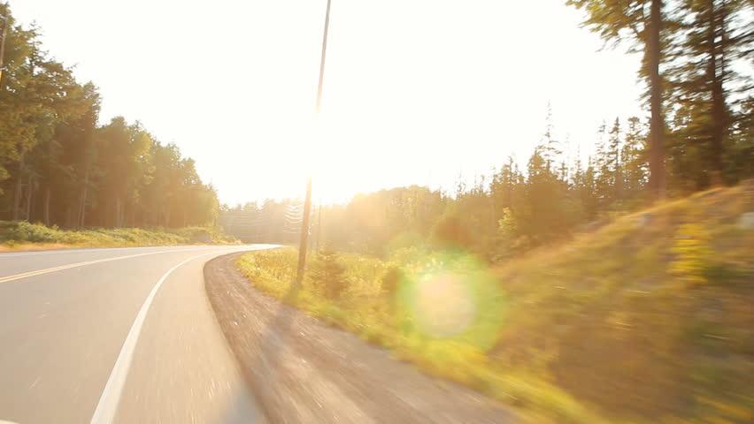 Summer drive with sun going down. Haliburton, Ontario, Canada.