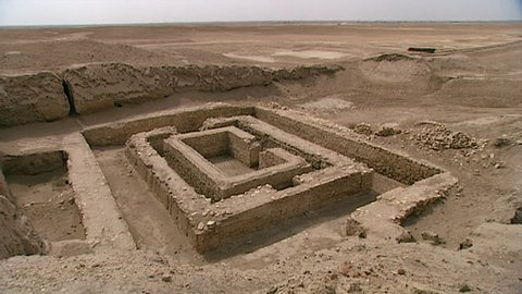 WARKA, IRAQ - CIRCA 2002: WIDE SHOT of White Temple (originally built atop the Anu Ziggurat) and Stone Building ruins. Part of the Anu district of ancient Uruk, dedicated to the Sumerian sky god Anu.