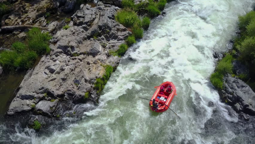 Overhead Aerial Shot of Rafting Boat on Raging River with Rapids 4K