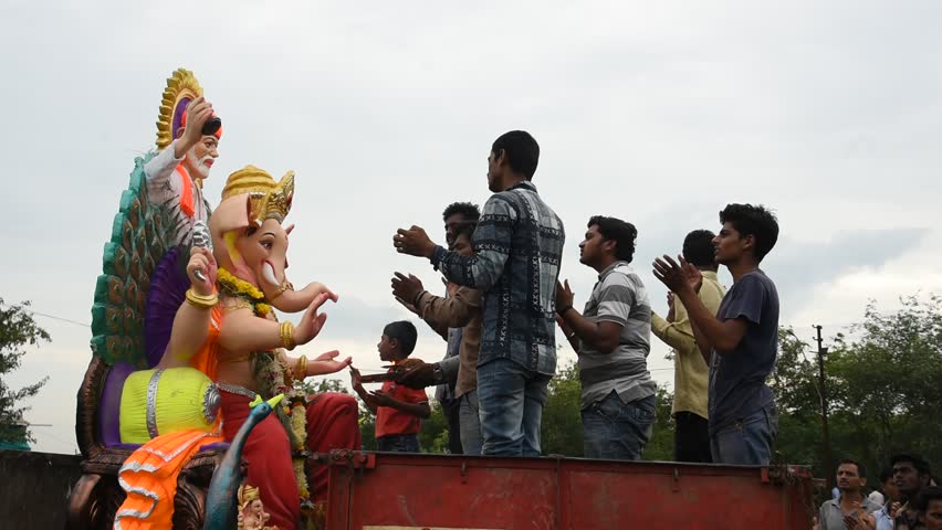 AMRAVATI, MAHARASHTRA, INDIA 5 SEPTEMBER 2017 : Unidentified faithful people perform pray of Hindu God Ganesha before immersion near water bodies, This is an annual festival.   Shutterstock HD Video #30541828