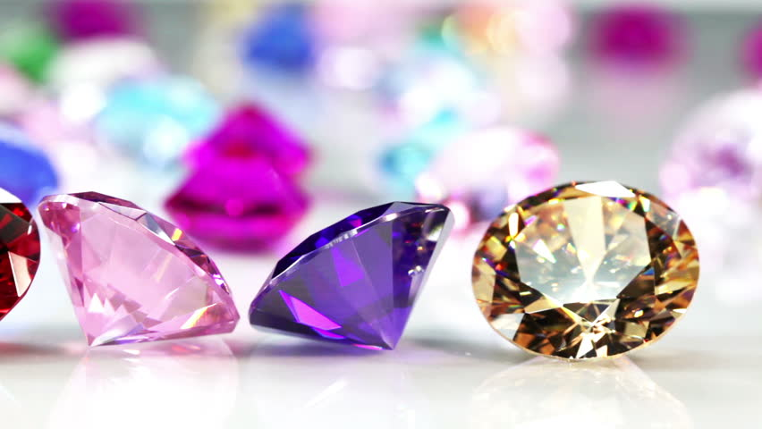 Blue Diamond,tourmaline pink,Amethyst Purple,Citrine Yellow,Iolite smokey blue, Topaz lighter blue,Peridot green,and colorful gems in white background.