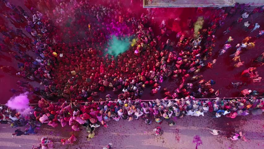 Color battle at the holi festival in India, 4k aerial shot #30611008