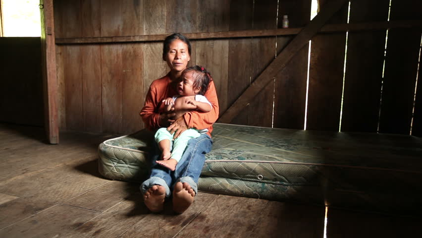 Mother and child living in very poor conditions, Ecuadorian Amazonia | Shutterstock HD Video #3061138
