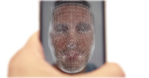 Smart phone facial recognition concept as male hold mobile with his fave on display and scanned using face id software