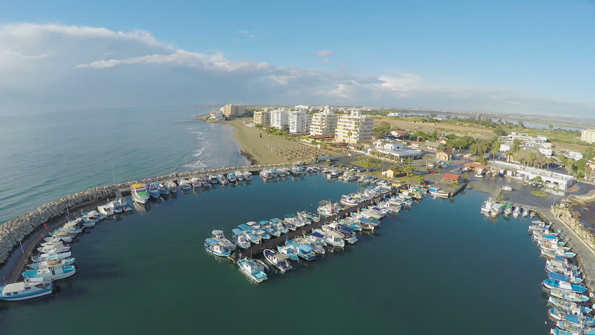 Panoramic view of Larnaca marina in Cyprus, aerial shot of port with yachts