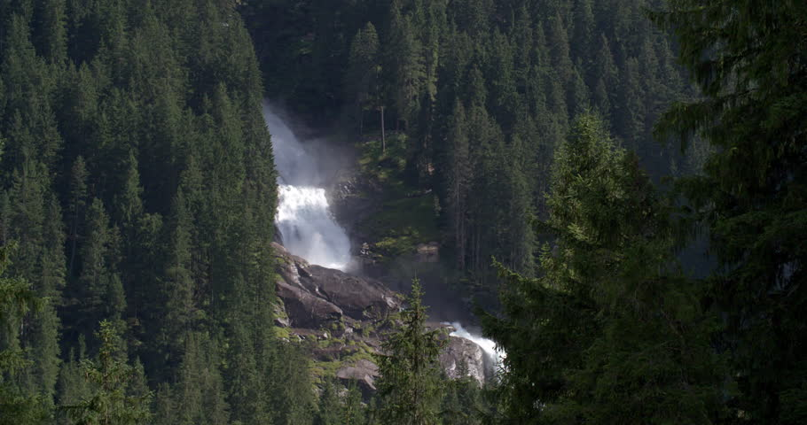 Spectacular amount of water streaming down the waterfalls of Krimml in Austria, long distance shot, 4K