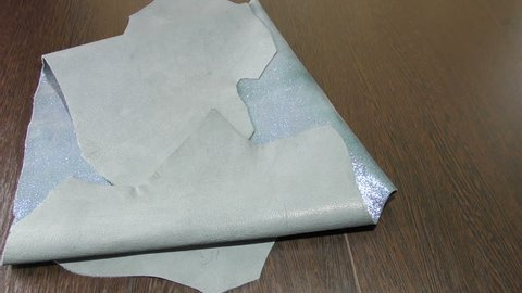 Silver-blue leather of sheepskin. Skin sheepskin with shine. Hides