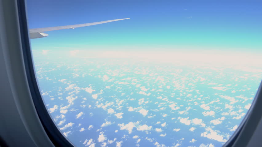 View from airplane window to the sky and plane wing, nobody #30736138
