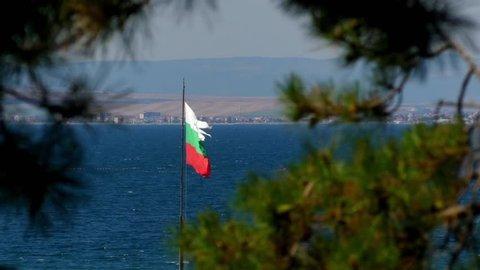 Transfer focus: Bulgarian flag in the Black Sea port city of Sozopol near Burgas in Bulgaria.