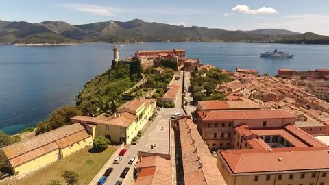 Drone shot following Via Falcone showing Napoleon Mill House and Forte Stella in Portoferraio, Elba, Italy, summer 2017