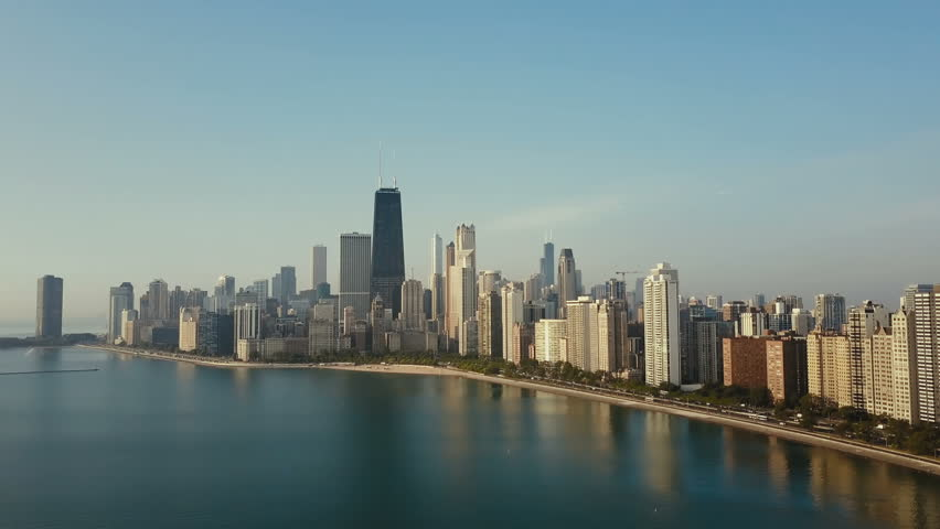 Aerial view of the downtown of Chicago, America and Michigan lake. Copter flying up to downtown on the dawn.