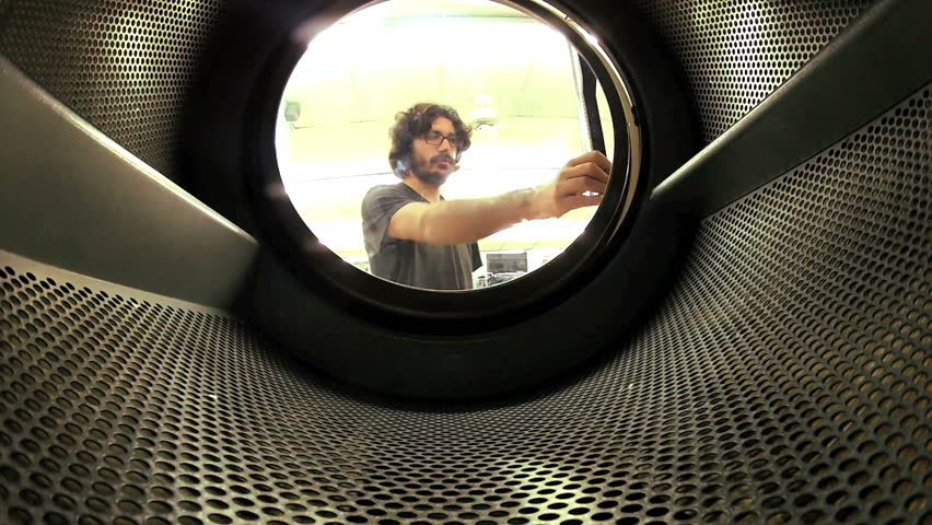 Man does laundry - Shot from inside washing machine | Shutterstock HD Video #3078271