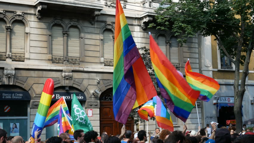 MILAN, ITALY – JUNE 24: Rainbow flags wave at Milano pride parade in Milan, Italy on June 24, 2017