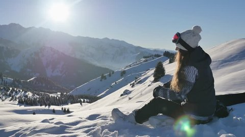 How to fasten the binding on snowboarding, how to ride. 4K footage, healthy lifestyle video. Sport. Winter