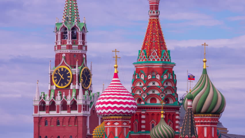Moscow Saint Basil's Cathedral and Kremlin Main Clock named Kuranti on Spasskaya Tower. Red Square. Timelapse.