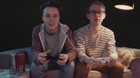 Two gamers in front of the screen are cutting in the online battle