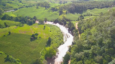 Aerial View. Flying over the beautiful mountain River with green rice field or terrace at Pai, Maehongson, Thailand.
