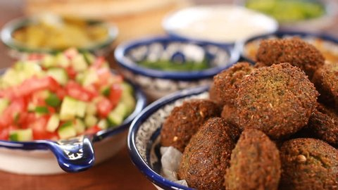 Cook Falafel or felafel deep-fried ball made from ground chickpeas Tahini Middle East