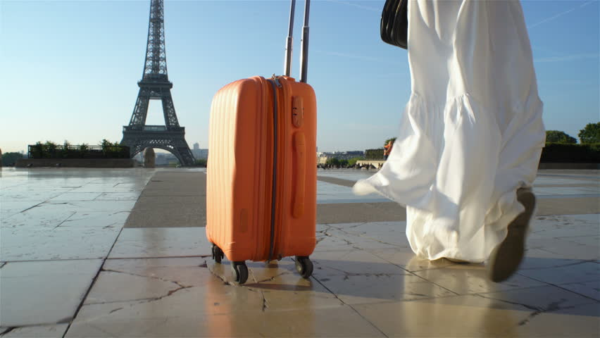 Young Woman with the Orange Suitcase Traveling to Paris. Eiffel Tower Background. | Shutterstock HD Video #30867736