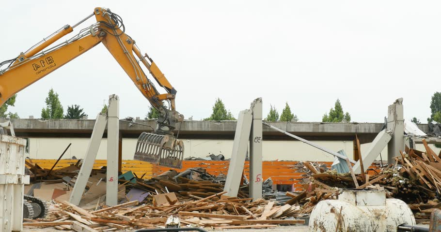 STRASBOURG, FRANCE - CIRCA 2017: Liebherr A 914 Litronic wheeled excavator cleaning debris on construction site