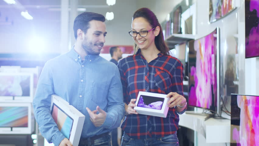 Happy Couple Walking In the Electronics Store, They've Purchased Newest Model of the Tablet Computer for Him and New Smartphone for Her. Shopping Center is Big, Bright and Full of Newest Electronics. | Shutterstock HD Video #30883939