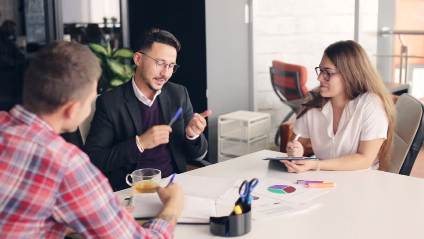 Group of happy business people brainstorming in office. | Shutterstock HD Video #30925558