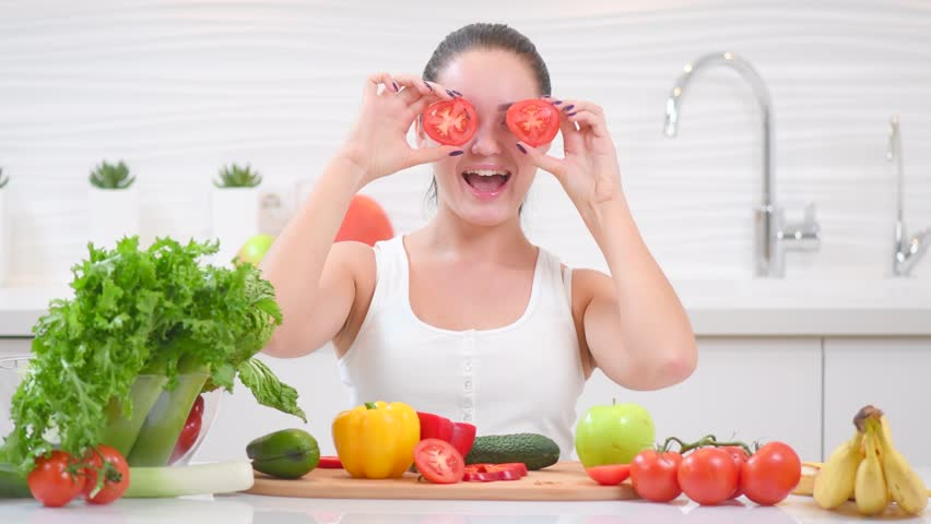 Beauty Young Woman Holding Fresh Tomatoes Vegetables And Smiling In Her Kitchen At Home Healthy