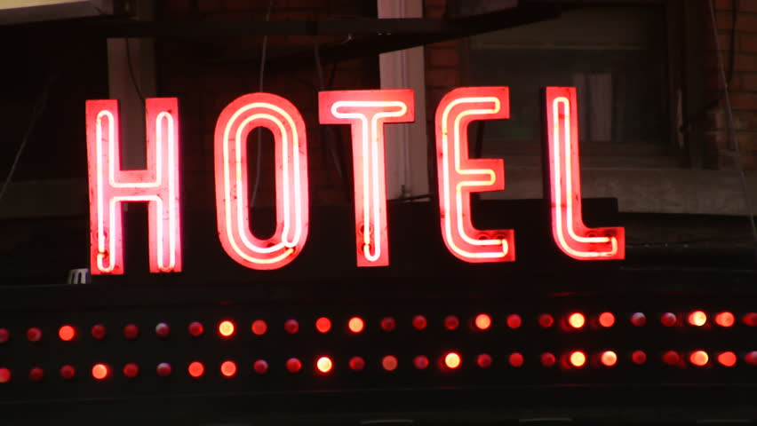 Hotel sign with flashing lights.