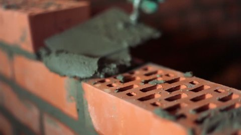 Brickwork process with trowel, closeup view and only hands visible
