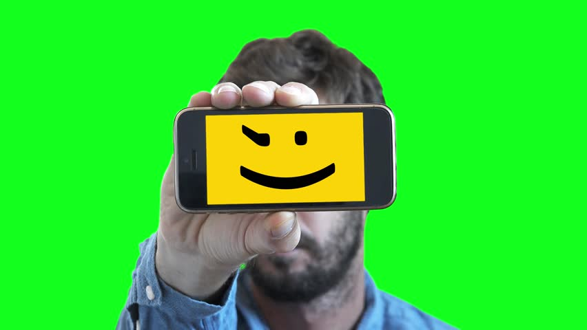 Man Winking In Smartphone Screen On Green Screen. Man shows his feelings through a smartphone with a Smiley face on screen | Shutterstock HD Video #30963928